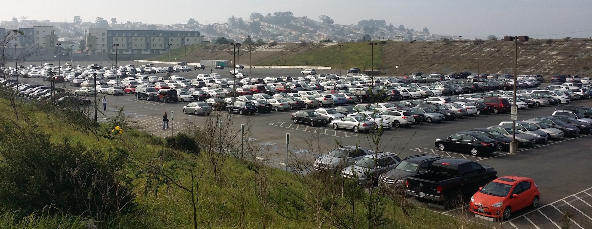 Site of the proposed Balboa Reservoir project, now a CCSF parking lot. © Madeline Mueller
