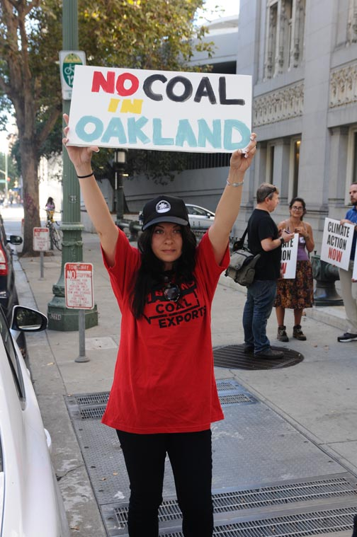 Demonstrator outside Oakland City Council hearing on coal. ©2015 Eric  K. Arnold