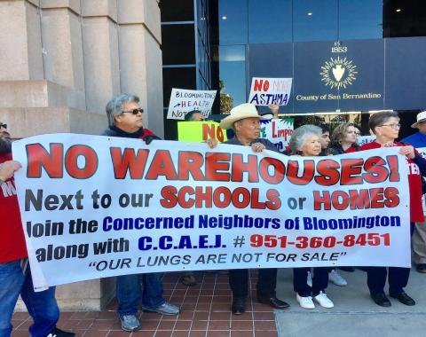 Bloomington residents and environmental advocates gather outside the San Bernardino County Government Center in February 2018 to protest warehouse development plans. ©2018 Anthony Victoria