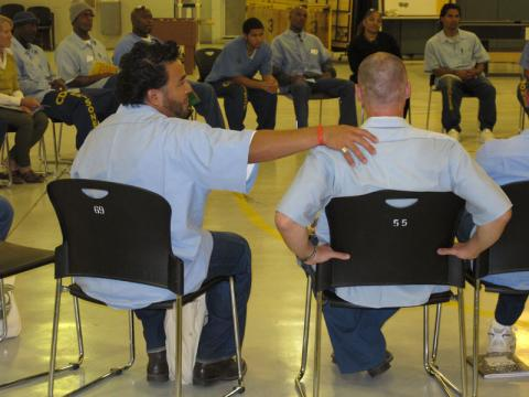 Circle Keeper Jose encourages a fellow inmate in talking circle. Courtesy of Jo Bauen