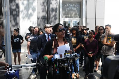 Cat Brooks leads a press conference at Oakland Police Department headquarters.  © 2016 Eric K. Arnold
